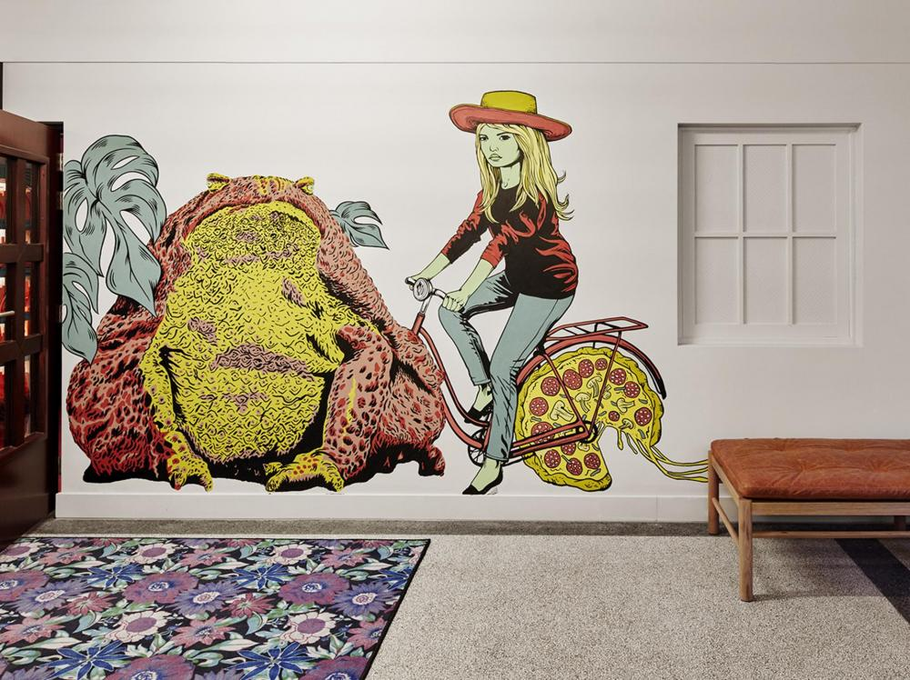 The wall graphics by local artists playfully emanate Amsterdam's culture.