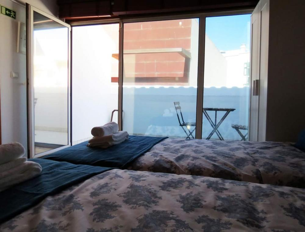 Double Room with private balcony and shared bathroom