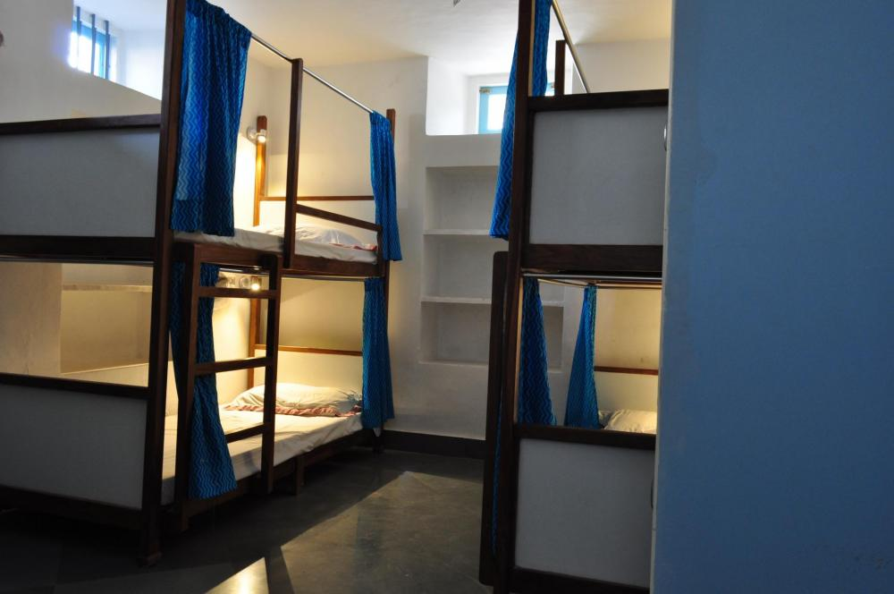 Air-Conditioned, Triple Bunk, Mixed  Dormitory On Split Levels. Two Triple Bunk