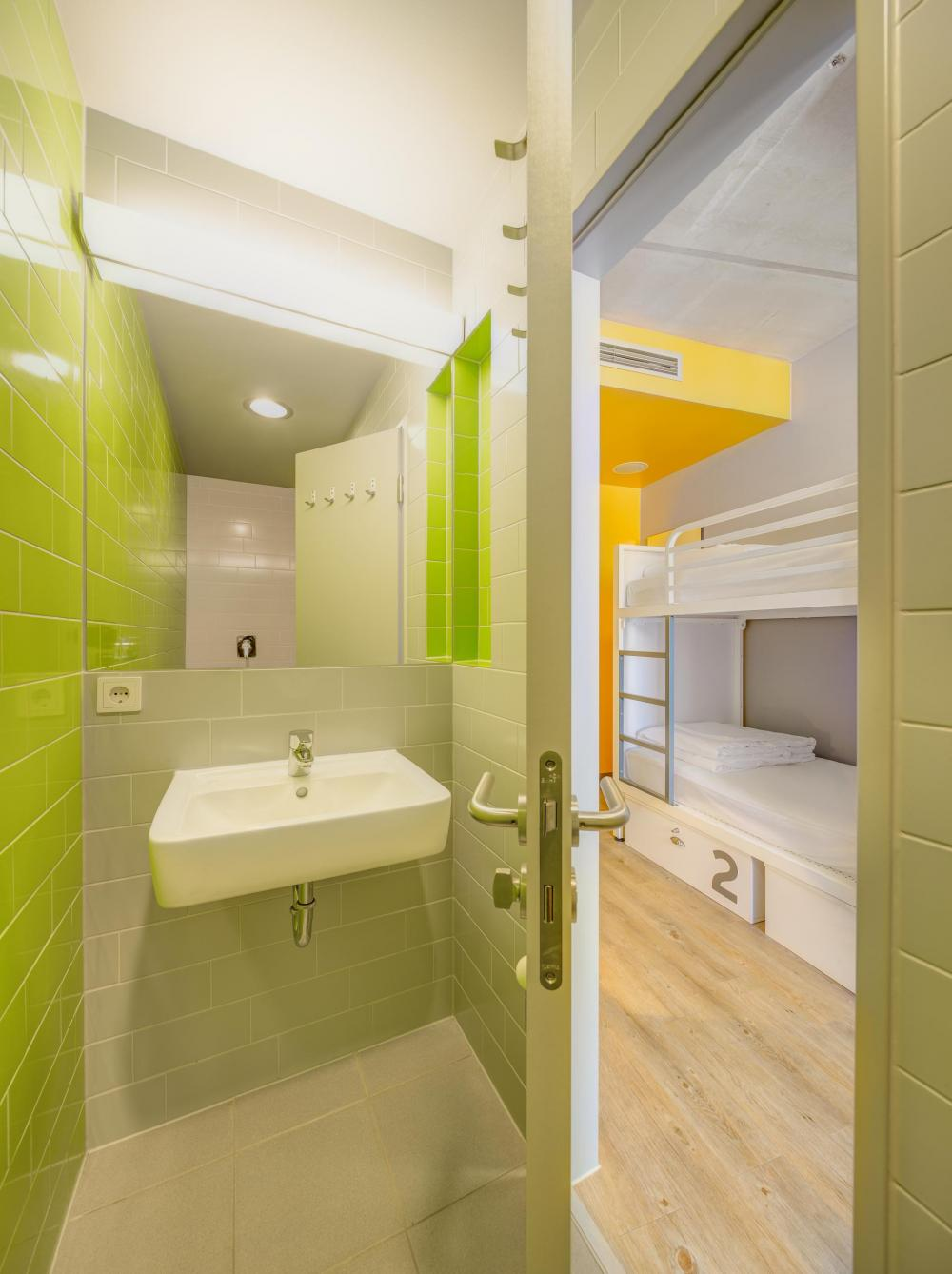 sample view of bathroom and bunk beds