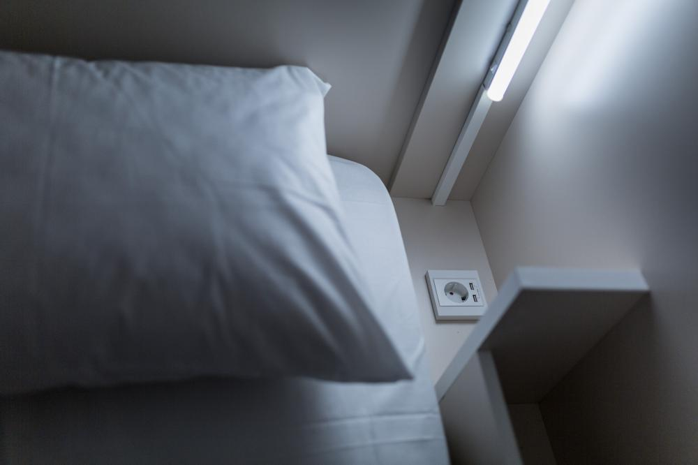 Socket and reading light next to the bed